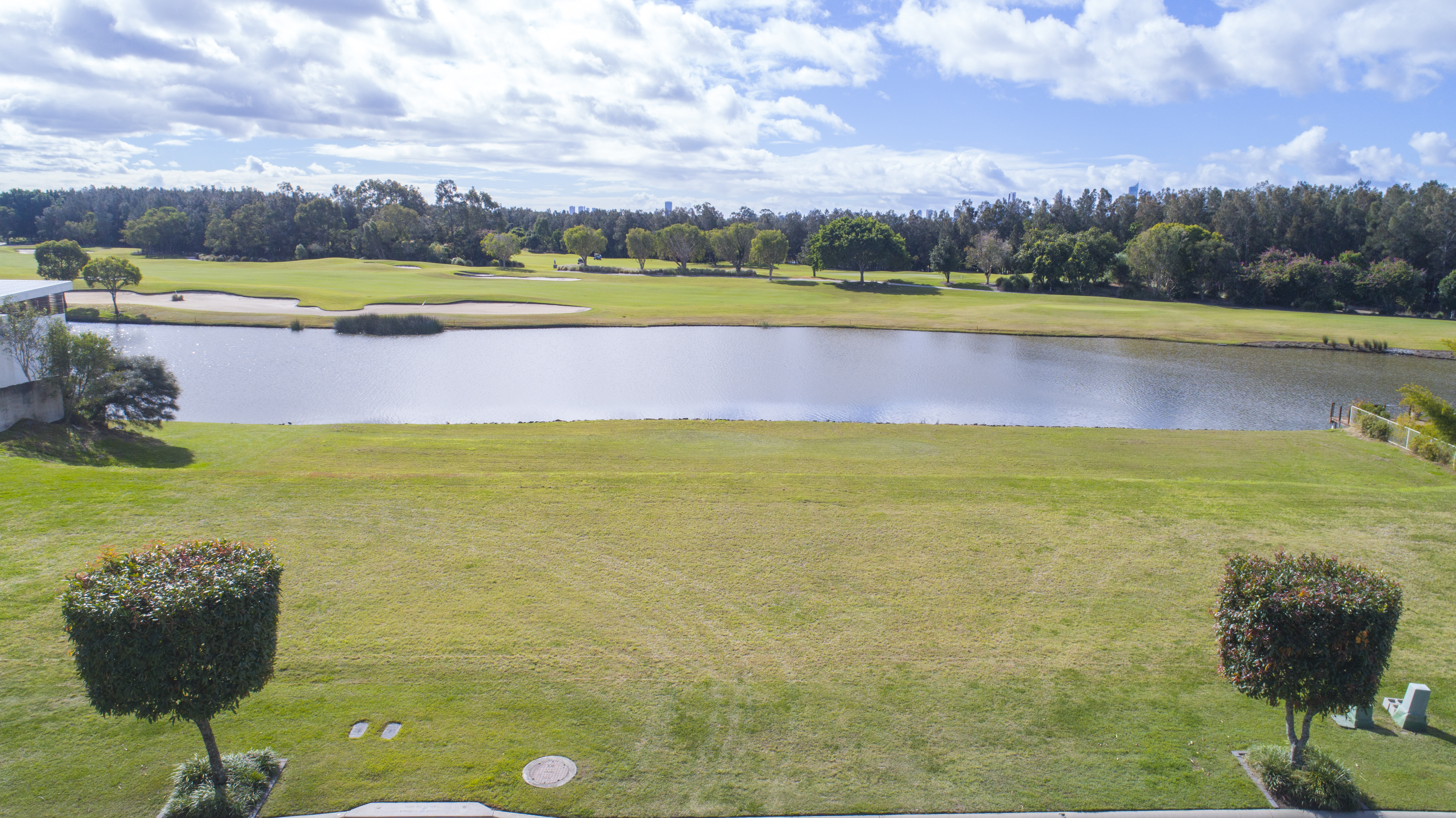 STUNNING WATERFRONT LAND WITH UNINTERRUPTED GOLF COURSE VIEWS